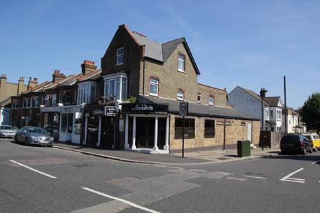 Freehold Restaurant (with vacant possession) and income-producing flat - London N21